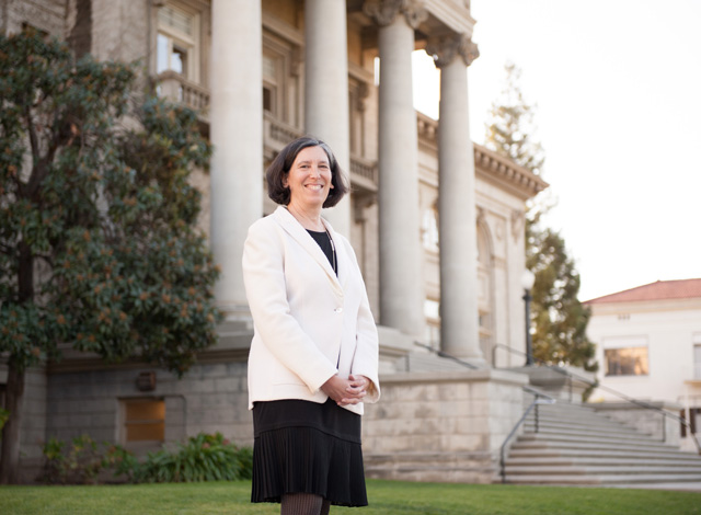 Nancy Wayne in front of Administration Building