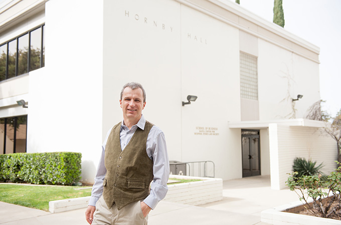 Professor Johannes Moenius outside the University of Redlands School of Business