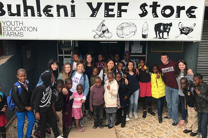Redlands team with Swazi children near a Hospital they rebuilt
