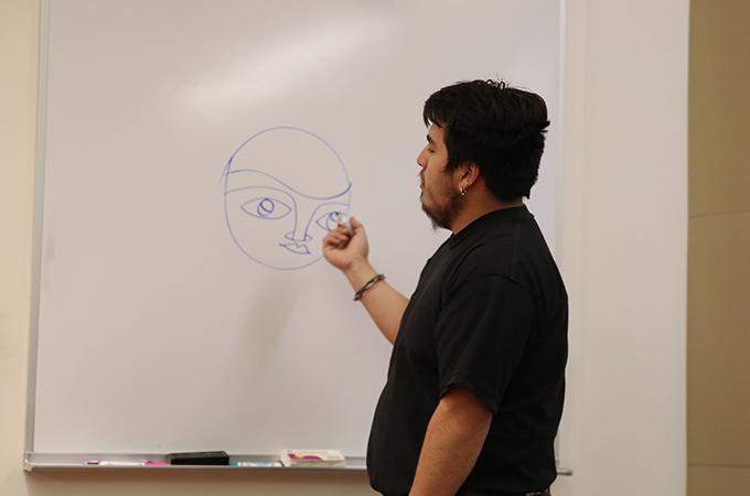 Camilo Díaz, an art student who paints with the Luchador Ernesto Miranda Muralists (UMLEM).
