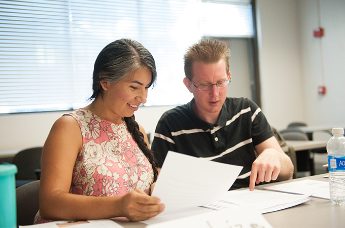 A female and male student studying.