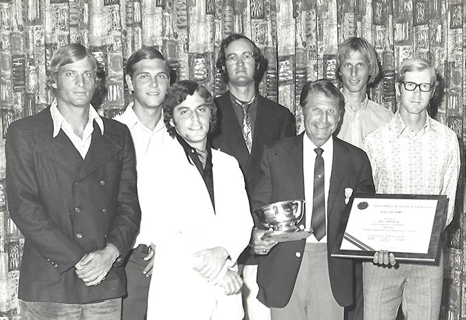 men standing in a group winning an award