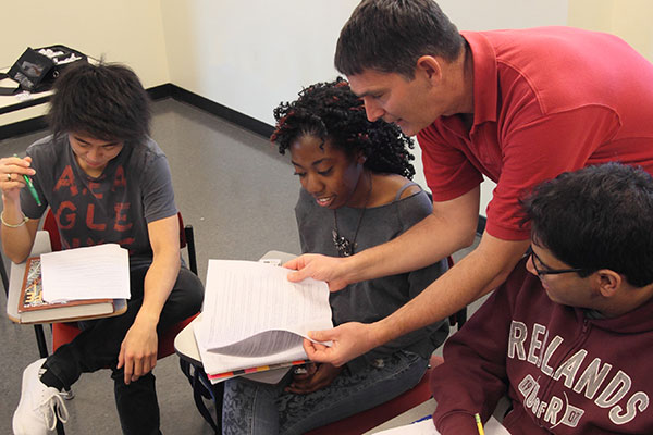 Professor working closely with students